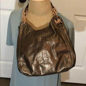 Used Michael Kors bronze snake style purse.